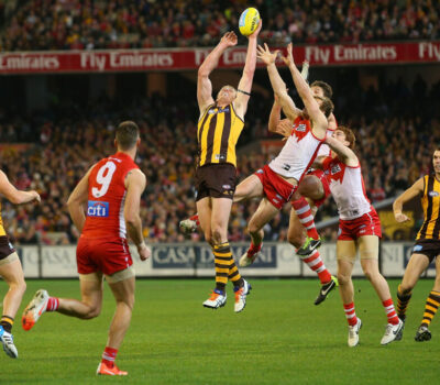 MELBOURNE, AUSTRALIA - JULY 26: Ben McEvoy of the Hawks competes for the ball during the round 18 AFL match between the Hawthorn Hawks and the Sydney Swans at Melbourne Cricket Ground on July 26, 2014 in Melbourne, Australia.  (Photo by Michael Dodge/Getty Images)